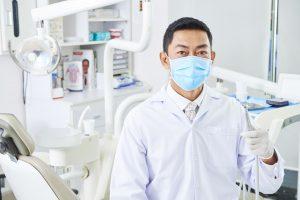 dentist-with-dental-drill-P4TB6X3