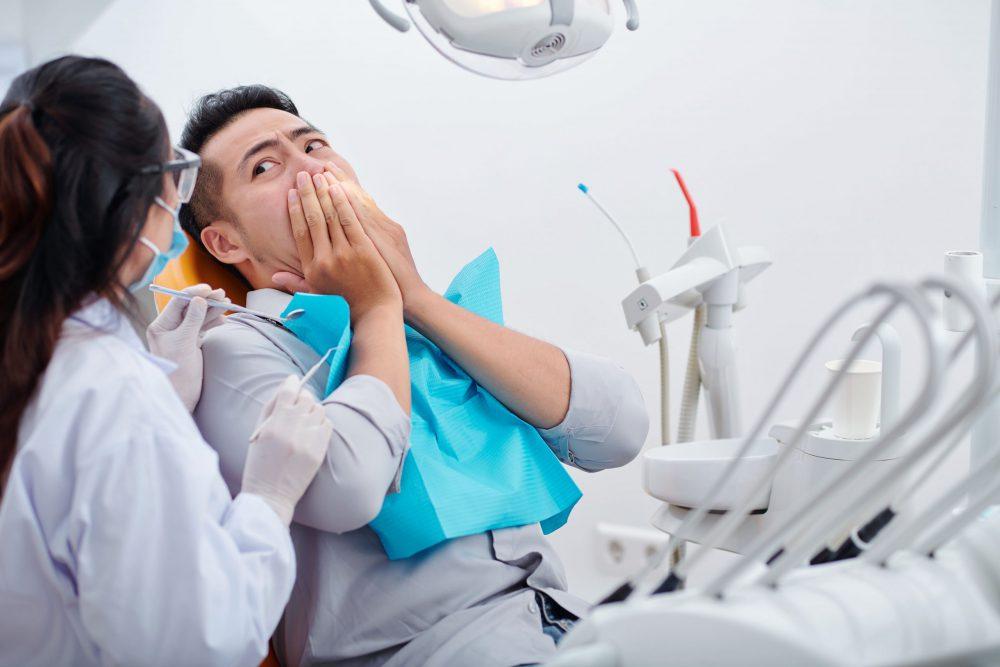patient-scared-of-dental-treatment-QTDTMF3
